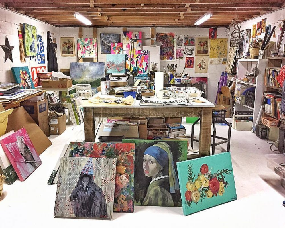 paintings in basement turned into artist man cave